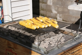 remainder of the corn being grilled for sides over the pig charcoals, brushed with drippings